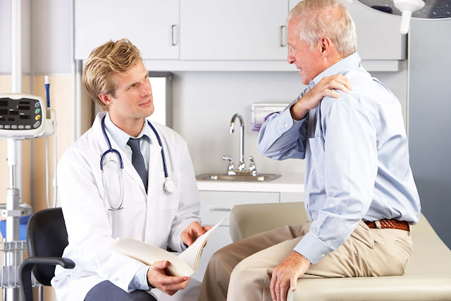 Older male patient visits doctor for shoulder pain.
