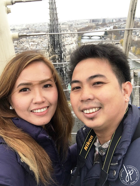man and woman selfie on rooftop