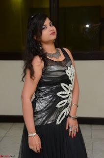 Shrisha Dasari in Sleeveless Short Black Dress At Follow Follow U Audio Launch 062.JPG