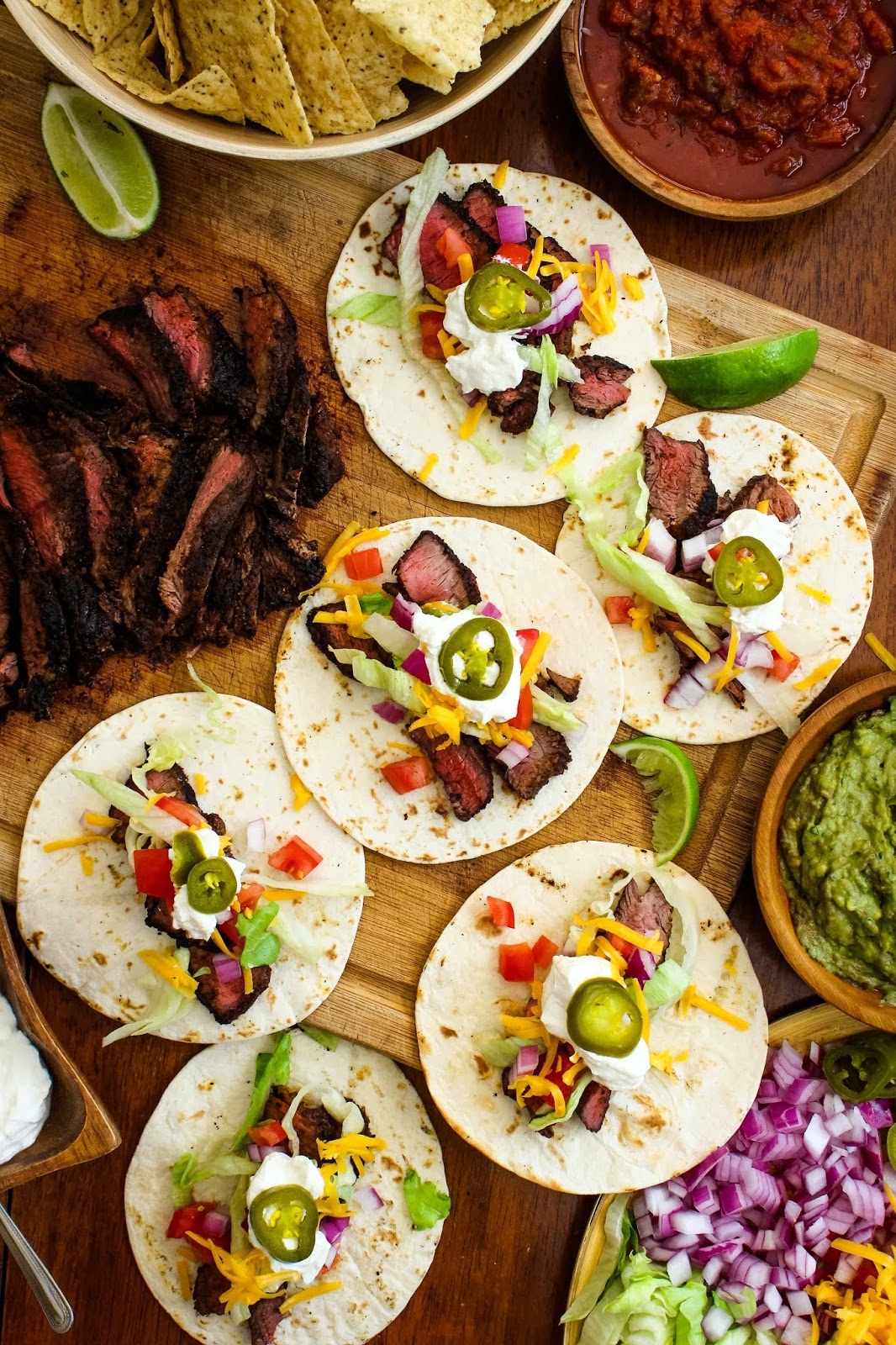 Grilled Sirloin Steak Tacos feature dry-rubbed grilled sirloin steak topped with all of your favorite taco toppings. You will want to make them all summer long! #tacos #steaktacos #grillingrecipe