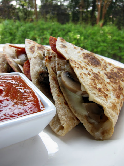 Pizzadilla Recipe - pizza quesadilla - all your favorite pizza toppings grilled in-between a tortilla. Serve with a side of warm pizza sauce - our favorite!! Great for a quick lunch or dinner.