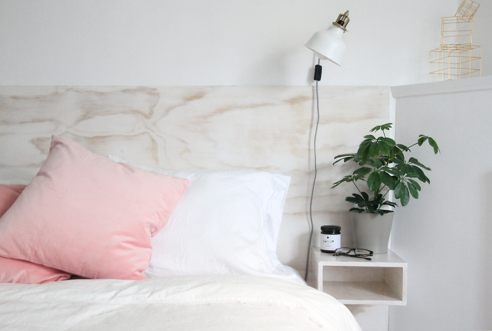 We're not only loving the floating bedside box shelves, but also the colour  of this headboard from Piper Winston.