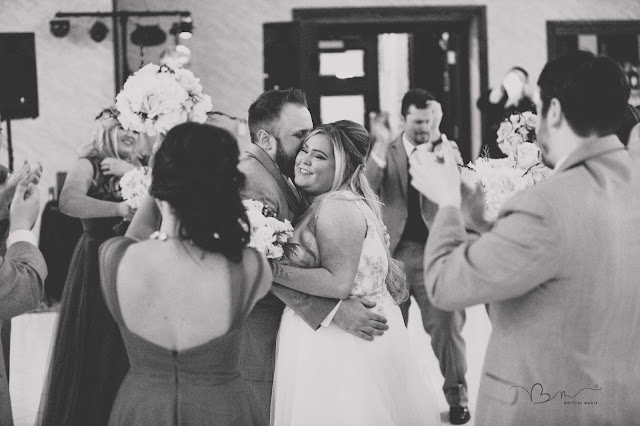 bride and groom hugging at  italian american cultural center in clinton township