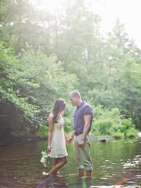 jeremy harwell, camping engagement photography session, outdoors, tents, river, trees, fire, bonfire, ruffled dress, spring engagement session ideas, summer engagement session ideas