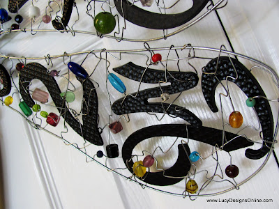 wire and beaded dragonfly wings with house numbers