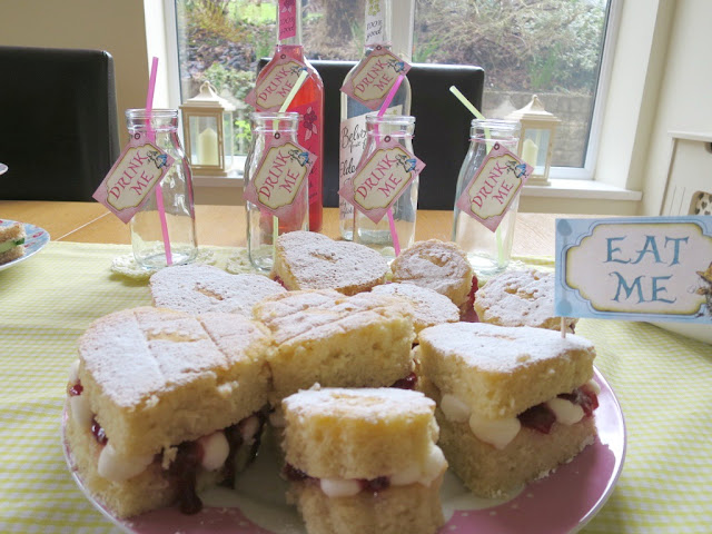 Home made birthday afternoon tea food and drink on Cath Kidston plates perfect for Spring mini victoria sponge filled with jam and buttercream