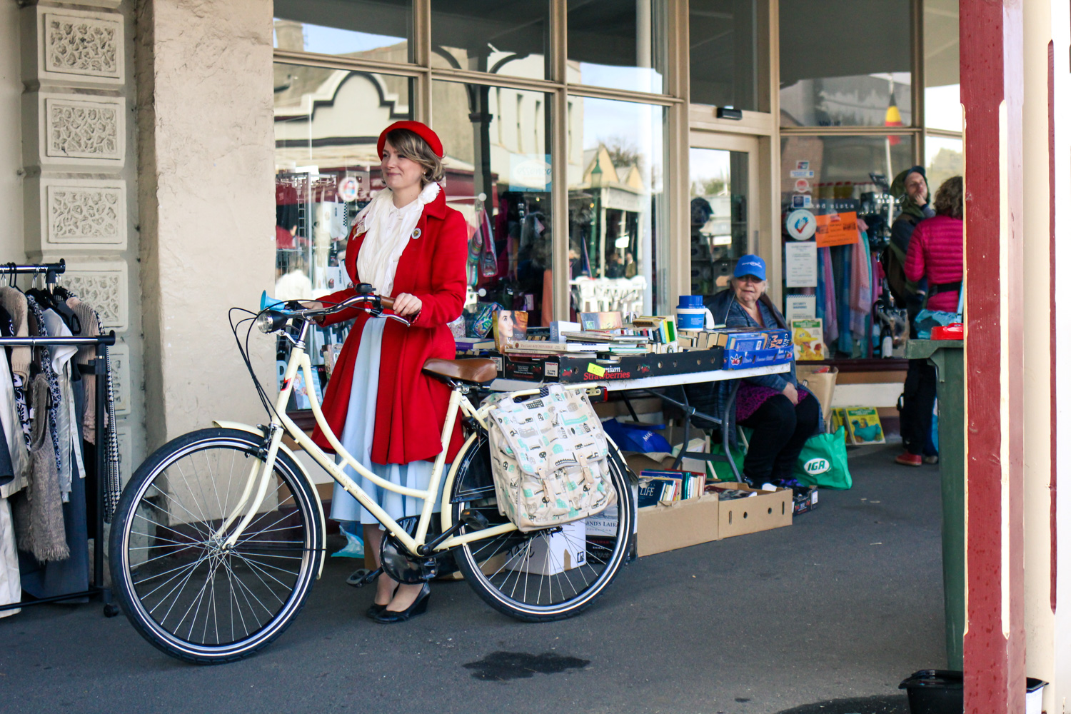 @findingfemme wears red Review Australia coat at Clunes Booktown Festival 2016 on a Lekker Bike.