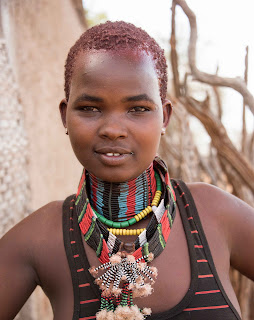 The Hamar tribe use red-ochre clay and animal fat to pleat and color their hair.