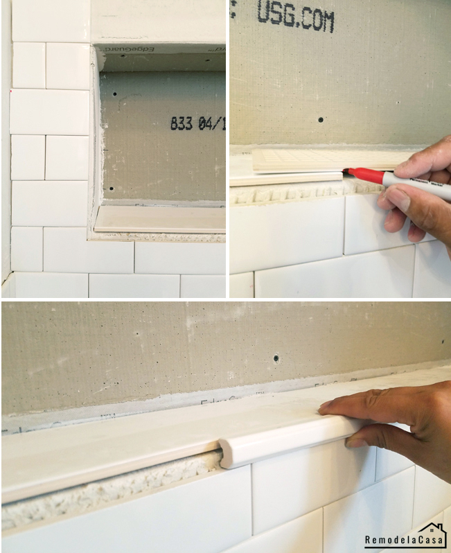 subway tile install in bathroom wall niche