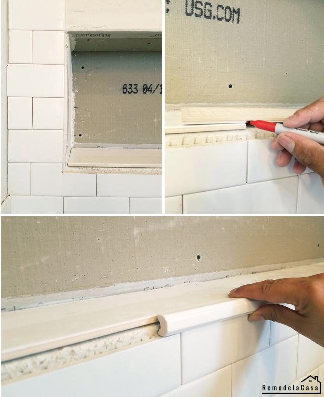 subway tile install in bathroom wall niche