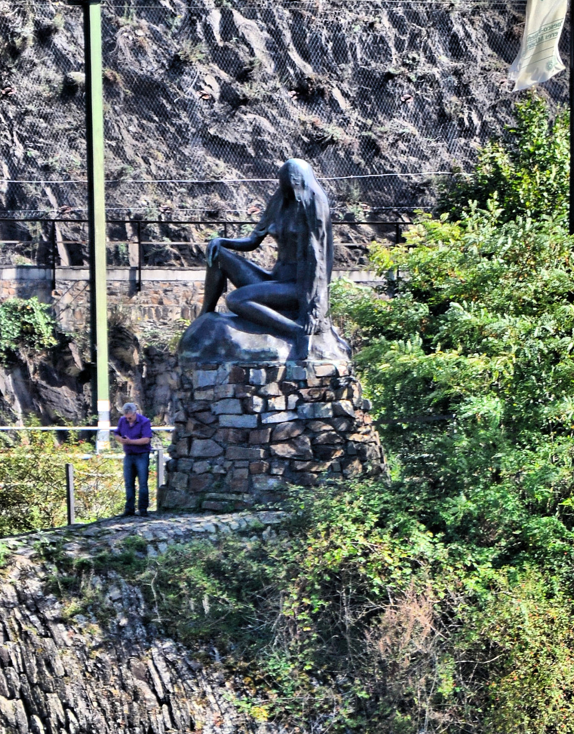 Loreley bides her time as she waits for the unwary sailor. This is one of two Loreley statues, this one along the bank of the river  and the other high atop the Loreley Rock.