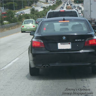 BMW with brake lights lit up in traffic on a freeway