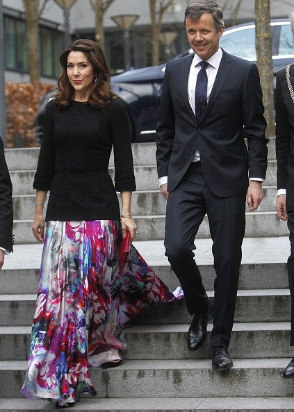 Crown princess mary wore Dolce and Gabbana floral skirt and carried Carlend Copenhagen Vanessa red Clutch bag