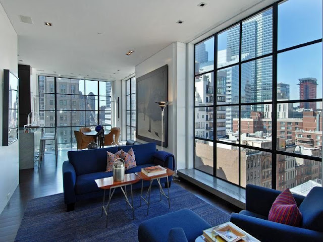 Photo of lovely living room with large windows in the Tribeca penthouse