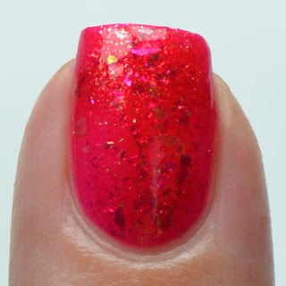 red jelly nail polish with shifting flakies