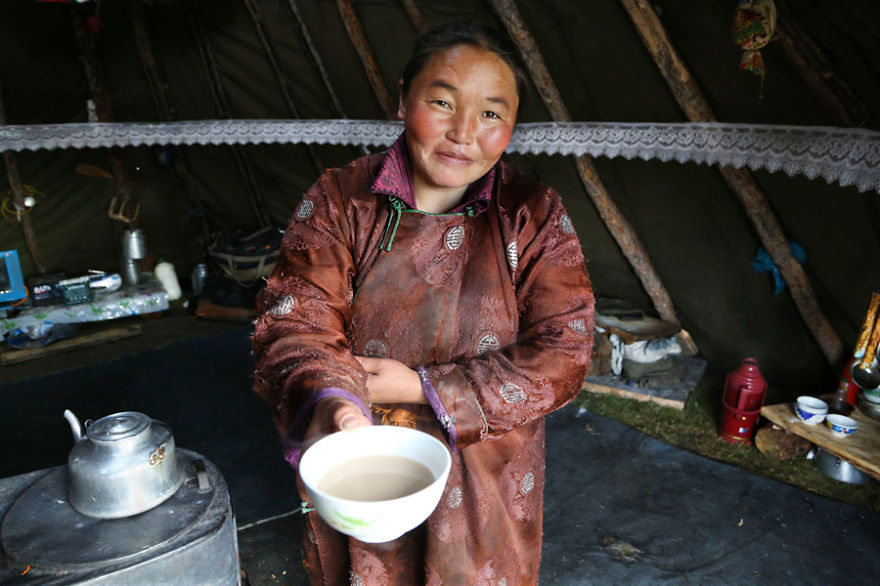 Narahuu's aunt is offering us a bowl of Suutei tsai, the traditional salty milk tea - Meet The Tsaatan Nomads In Mongolia Who Live Like No One Else