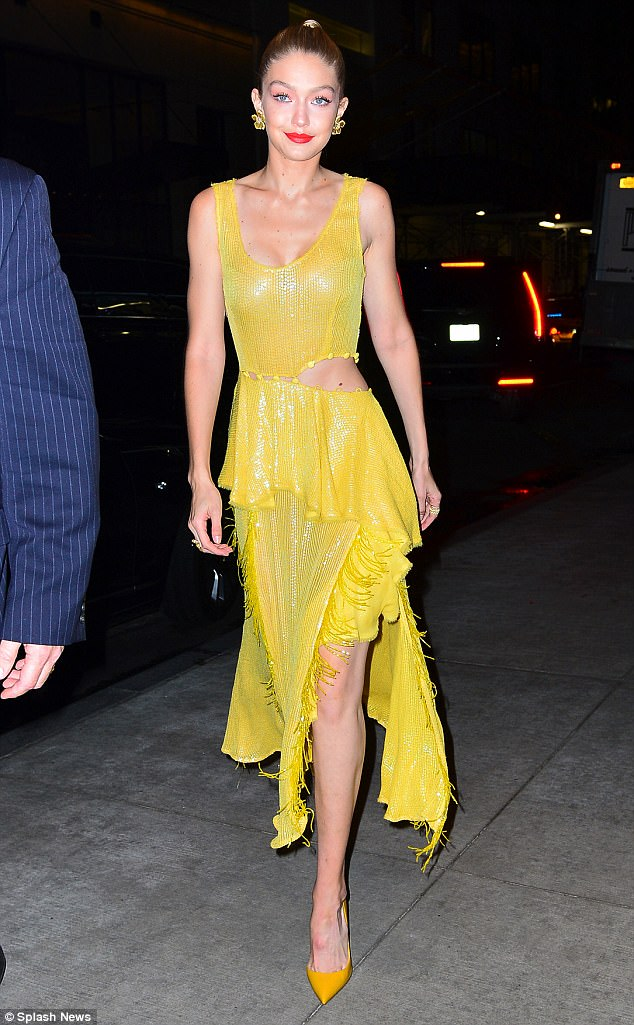 Gigi Hadid shows off her tiny waist in midriff-revealing yellow dress at All I See Is You screening in NYC