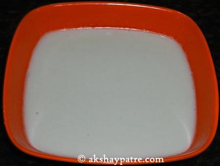 thick coocnut milk extracted - preparing pumpkin kheer