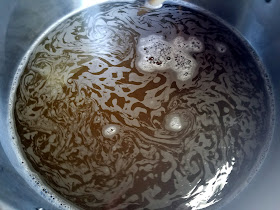 The wort coming to a boil