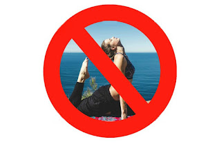 Yoga pose inside No Entry sign.