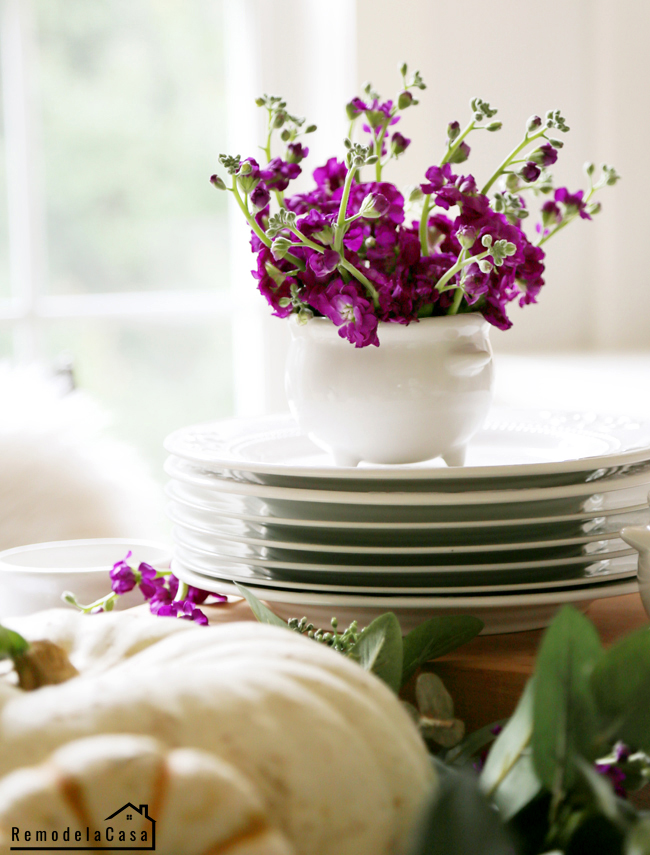 Purple flowers on bowl and big pumpkin centerpiece