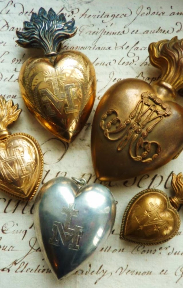 Sacred antique milagro ex-voto hearts from France and Italy.