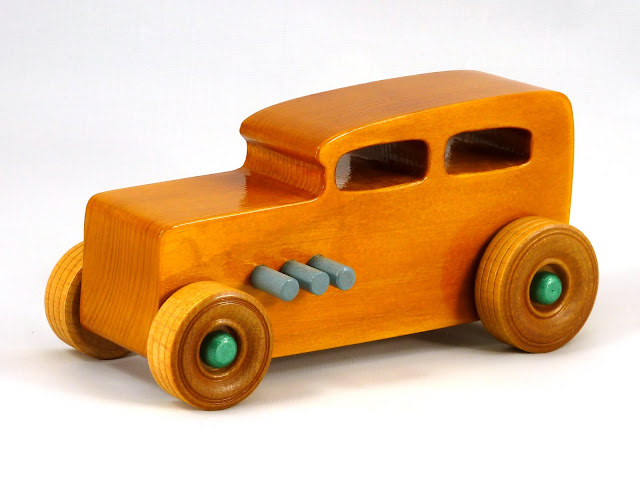 Left Side Front - Wooden Toy Car - Hot Rod Freaky Ford - 32 Sedan - Pine - Amber Shellac - Metallic Green - Gray