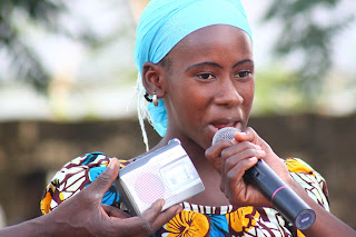 A youth participant gives a speech during the afternoon ceremony.