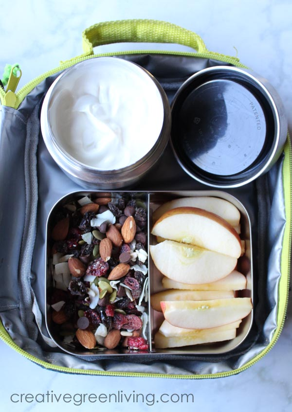 Make a yummy bento box with apple slices, yogurt dip and trail mix