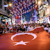 Turkish football supporters take part in a rally against the military coup