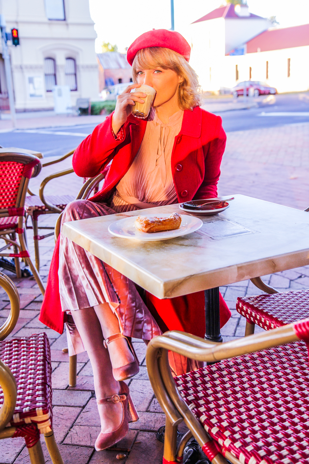 Liana of @findingfemme wears red and pink and sips on a chai at Le Peche Gourmand in Creswick