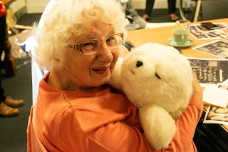 Jean and Paro, the Robotic Seal, meet each other
