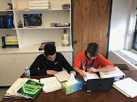 Pictured here are two 8th Graders working hard on their English assignment.
