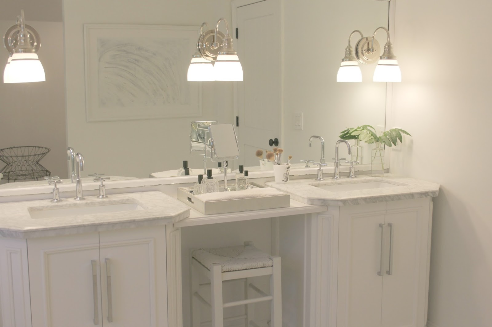 White vanities with carrara marble tops in renovated bathroom. Come see renovation photos in Before & After: My Home Renovation.