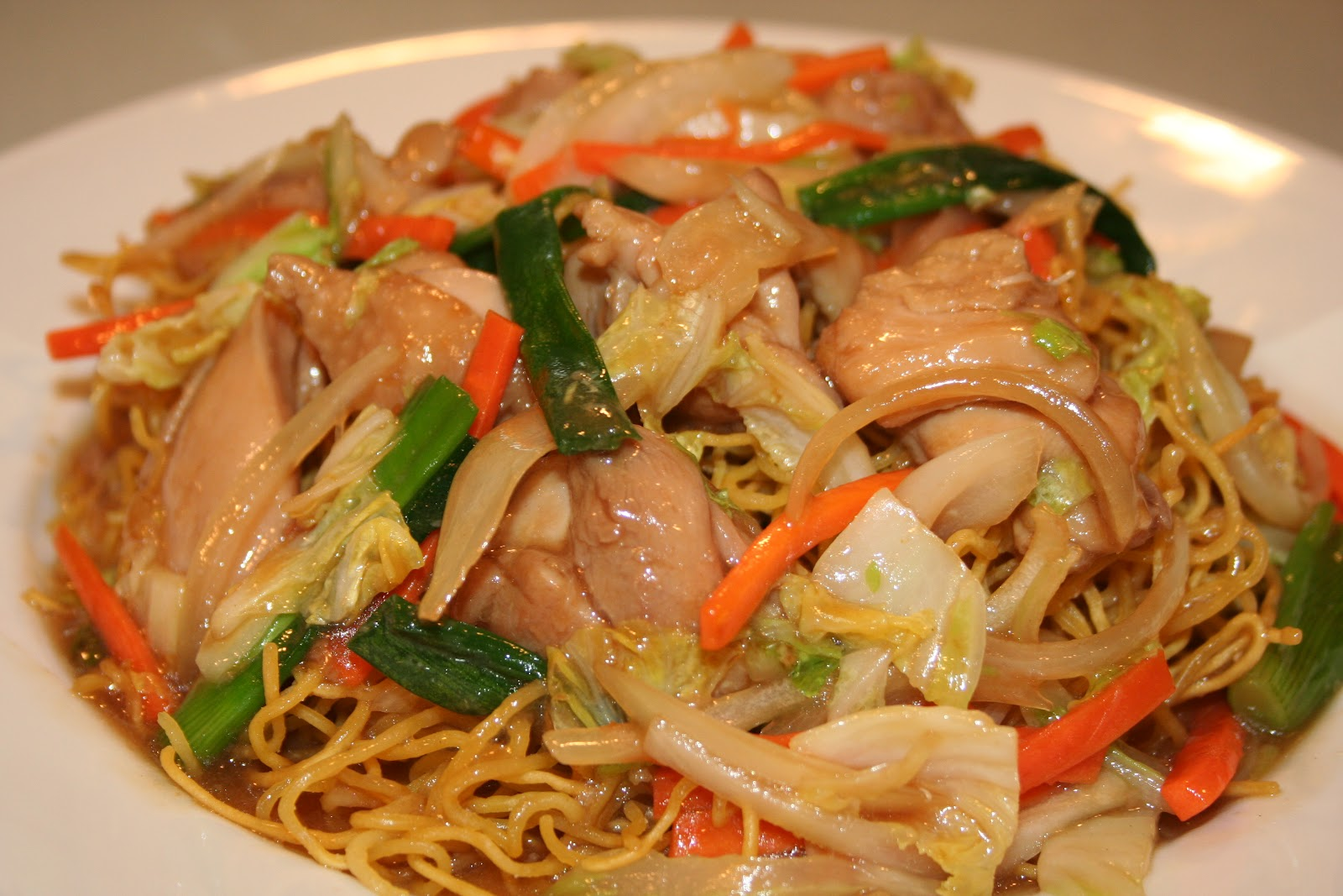 chow mein This authentic cantonese version of chow mein features fresh egg noodles, which are fried into a cake that softens slightly when topped with a meat and vegetable sauce.