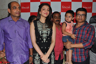 Kajal Aggarwal in lovely Black Sleeveless Anarlaki Dress in Hyderabad at Launch of Bahar Cafe at Madinaguda 011.JPG