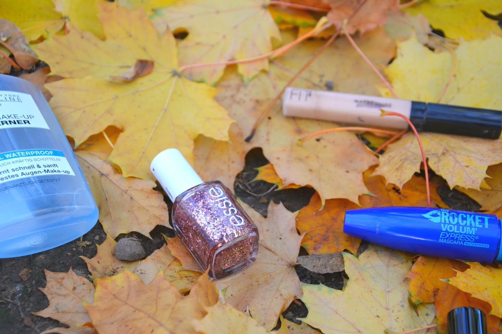 Maybelline Eye Makup Remover, Essie Nail Polish, Maybelline Fit Me Concealer, Maybelline The Rocket Volum Express Mascara on Autumnal Leaves