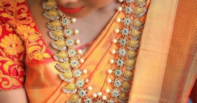 Bride In Pearls Kundan Mango Mala Jewellery Designs
