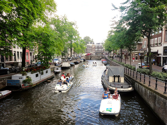 Boats and pedalos in the canals of Amsterdam | Netherlands, Europe