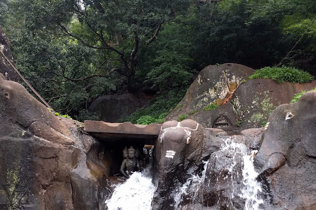 Three elephants carved out of the rocks at the Kalhatti falls