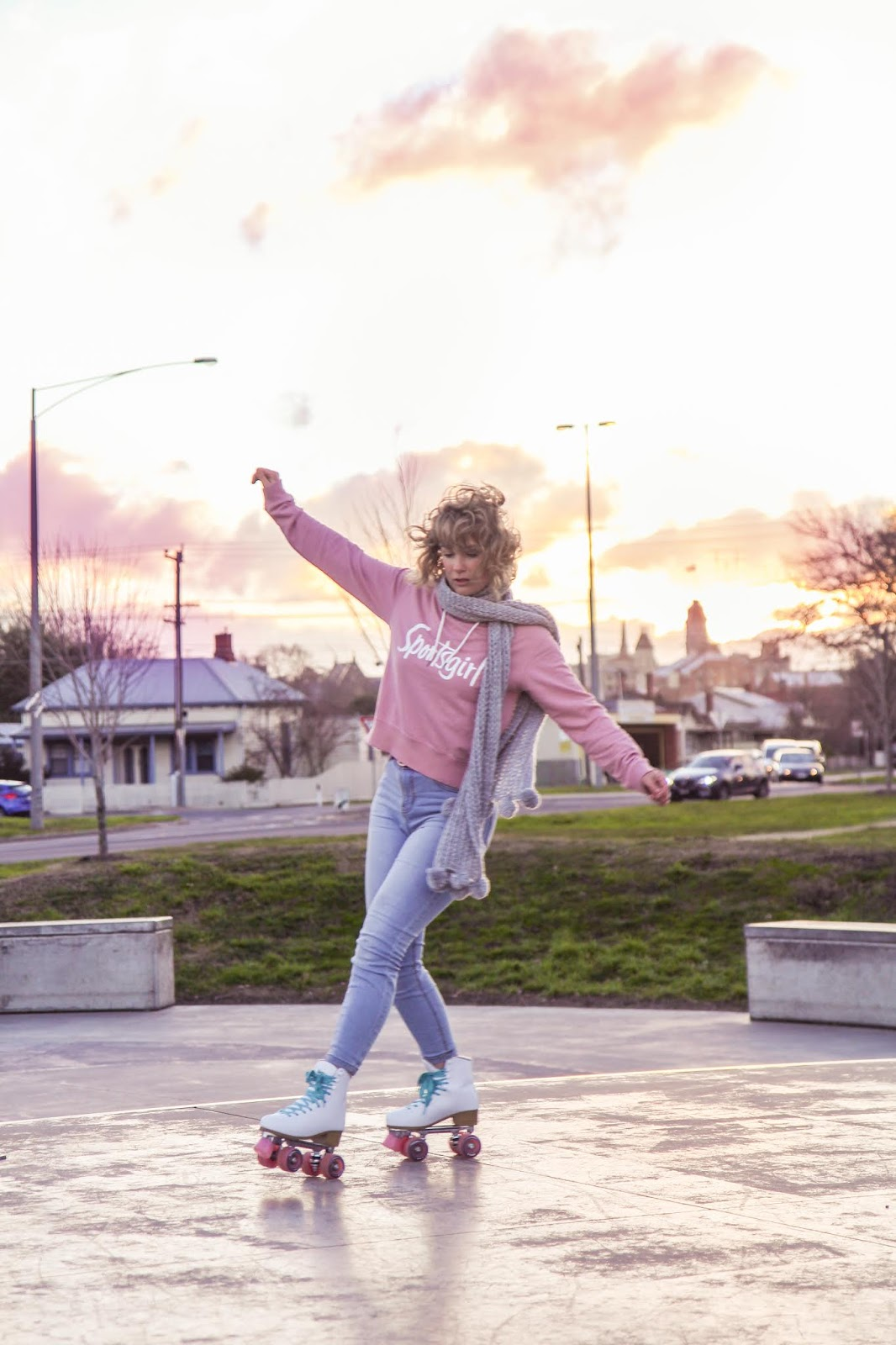 Liana of @findingfemme in Impala rollerskates and pink Sportsgirl hoodie