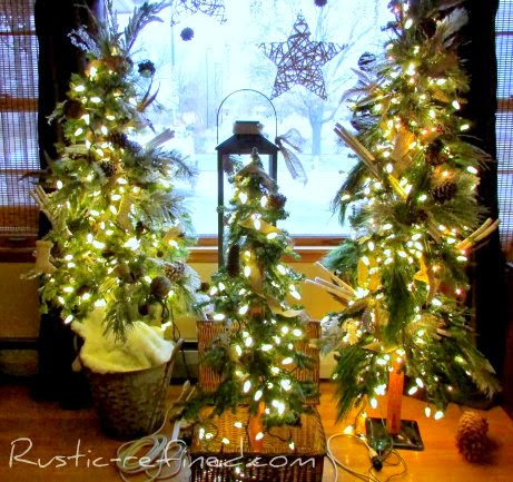 Rustic holiday tree decorating for Christmas. Using Outdoor elements  and a modern style tree, I added woodsy touches such as owls, twigs, burlap, feathers and icicles and plenty of holiday lights. It really brings nature indoors during the cold winter months.