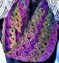 http://translate.google.es/translate?hl=es&sl=en&tl=es&u=http%3A%2F%2Fwww.crochetgeek.com%2F2013%2F04%2Fcrochet-infinity-scarf-aquatic-blossom.html