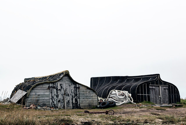 Upturned boat hulls converted into sheds on Holy Island by Martyn Ferry Photography