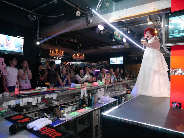 "A drag queen takes the stage at Osaka gay bar ""Village."""
