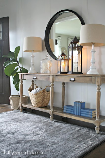 wood table in foyer white wall