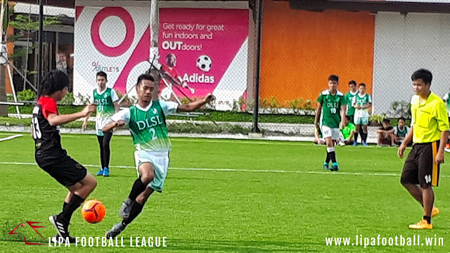 Action in the Round 2 match between Green Stallions FC and Kings FC.