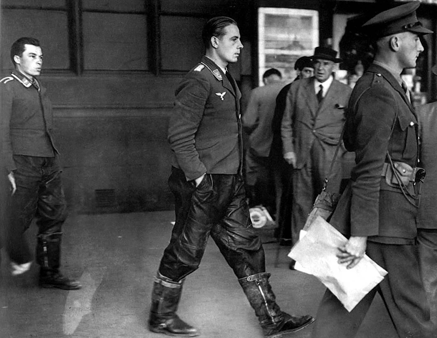 Two captured Luftwaffe bomber pilots walking among London citizens, September, 1940