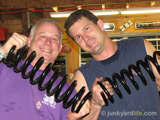 Holding the 1955 Chevy replacement heavy duty coil springs.