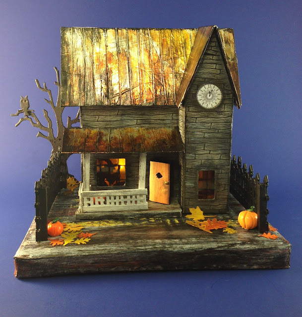 Rusted Tin Roof Halloween House witch in window - paper and cardboard house for Halloween decor #putzhouse #halloweenhouse #littlecardboardhouse